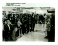 Aircraft Skyjack All Nippon 747 1995: Stranded passengers at Hakodate Airport watch television news of the hijacking of the other All Nippon Airways.