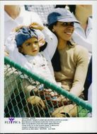Boris Becker's wife Barbara Feltus and son Noah in the audience during Becker's match against Michael Chang in Colonial Classic