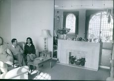 Peter II of Yugoslavia and wife Alexandra of Yugoslavia sitting in the living room talking to each other, 1960