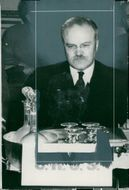 Molotov had many glasses and ice-cold drinks in front of him when the conference in Paris opened in tropical heat