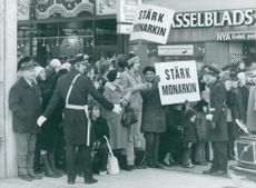 Demonstrators outside the Parliamentary House at the opening of the Riksdag