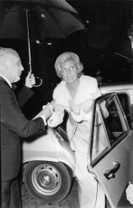 Georges Jean Raymond Pompidou giving hand to a woman, to come out of the car.