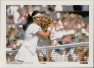 Steffi Graf gets a hug by Arantxa Sánchez Vicario after defeating her at the Wimbledon Championship