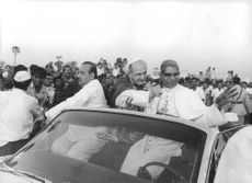 Pope Paul VI inside a roofless car parading for the people.  Taken - Circa 1964