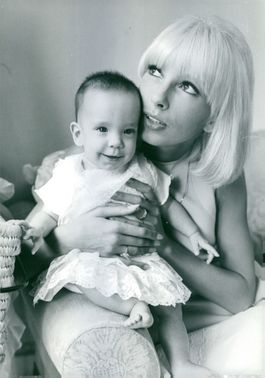 Dany Saval holding a child.  - May 1966