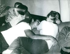 Men and women lying down together. 1972
