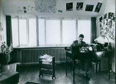 Carl, Duke of Württemberg sitting and writing inside his office. 1959