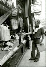 Tennis player Stan Smith during a shopping trip.