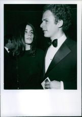 A photograph of Art Garfunkel and his wife.