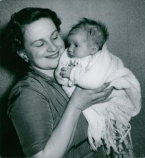 Warm hug of a mother. May 1955