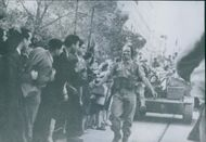Allied troops receive a terrific reception as they pass through the town. 1943.