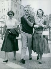 Prince Bernhard of Lippe-Biesterfeld seen walking with his two daughters Princess Irene (right) and Princess Beatrix.