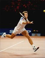 Stefan Edberg throws himself behind the ball during the Stockholm Open.