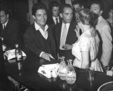 Jacques Charrier with friends, smiling.