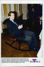 "Tennis player Stefan Edberg is sitting in a rocking chair as a symbol of his ""retirement"" from the tennis at a dinner in conjunction with the Davis Cup 1996"