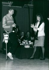 Sarah, Duchess of York presenting an award to a disabled skier.