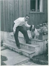 Jan Baalsrud posing for the camera with his dog.