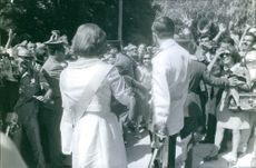 Princess Alexia and her husband Carlos Morales Quintana surrounded by people. 1965.