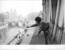 Pascale Petit leaning out of window.
