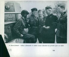 Russian and German troops in conversation by a BA-I armoured car at the captured town of Brześć Litewski (Brest-Litovsk), 1939.