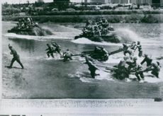 Soviet tanks and troopers crossing the river.