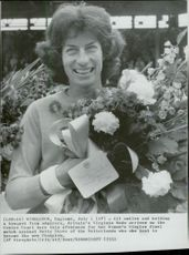Virginia Wade with a bouquet of flowers after the win in Wimbledon