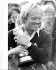 Golf player Jack Nicklaus with the trophy