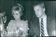A couple drinking at a party.  - Dec 1964