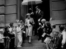 Queen Elizabeth II visiting school with King Carl XVI Gustaf