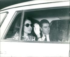 Princess Soraya sitting with man.