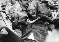Rabbi Abraham Levinger being carried away by cops.