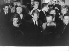 Robert F. Kennedy and his wife among crowd.