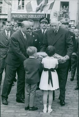 Charles De Gaulle recieving presents from the children. June 21, 1965