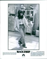"Director Penelope Spheeris demonstrate how to walk across a tilted floor fro a scene in the comedy ""Black Sheep."""