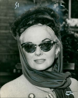 Actress Anne Todd leaving her home for court