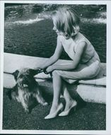 Woman siting with the puppy. 1962