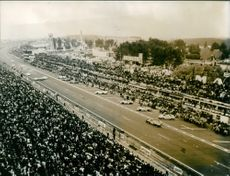 A aerial view of a car racing Olympic.