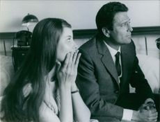 Italian footballer and film star Raf Vallone is looking at something with his wife Italian actress Elena Varzi