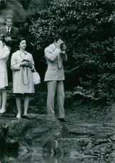 Gustaf VI Adolf with Princess Margaret taking picture on something, 1970.