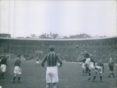 Footballers playing football in the ground during football match. 1936