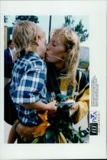 Susanne Gunnarsson hugged about his son after the win during the Olympic Games.