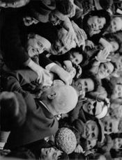 Charles André Joseph Marie de Gaulle surrounded by people.