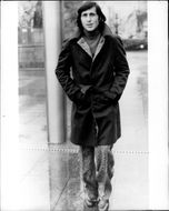 The tennis player Ilie Nastase shows a trenchcoat by tailor Guy Laroche