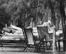 Claudia Cardinale relaxing with son Patrizio and Franco Cristaldi.