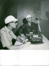 Two General officers sitting in the control room, holding telephone, 1968.