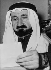 Sheikh Youssef Yassin holding a piece of paper.