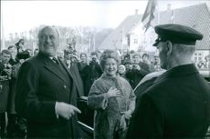 Princess Benedikte and Prince Richard being welcomed by the people and smiling during an event.