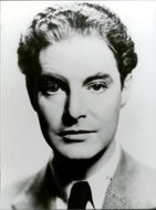 Black and white portrait photography of British actor Robert Donat.