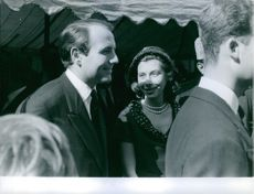 Prince Sadruddin Aga Khan conversing with his wife Nina Dyer.