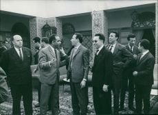 Ahmed Ben Bella with people in discussion.